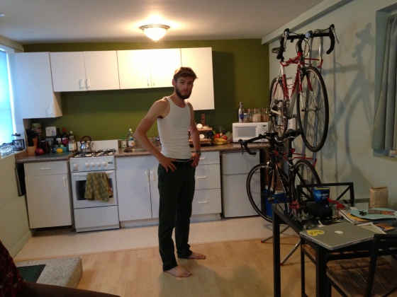 chris hanging our bikes with care. in the kitchen.