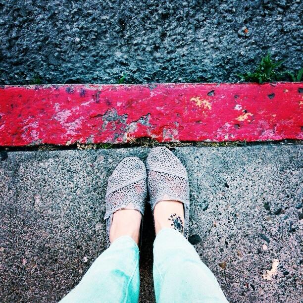 feet on the street of San Francisco