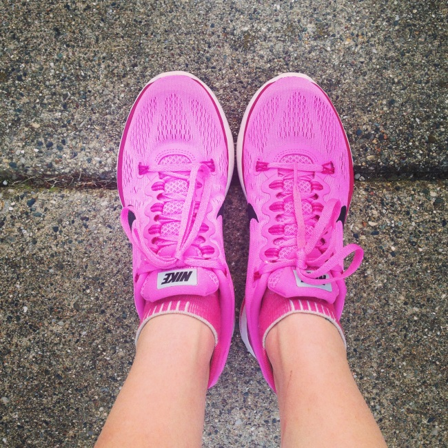 pink running shoes on pavement